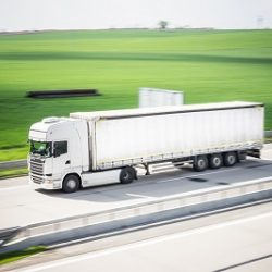 white-tir-truck-in-motion-driving-on-highway-picjumbo-com_400x267