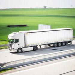 white-tir-truck-in-motion-driving-on-highway-picjumbo-com_400x267